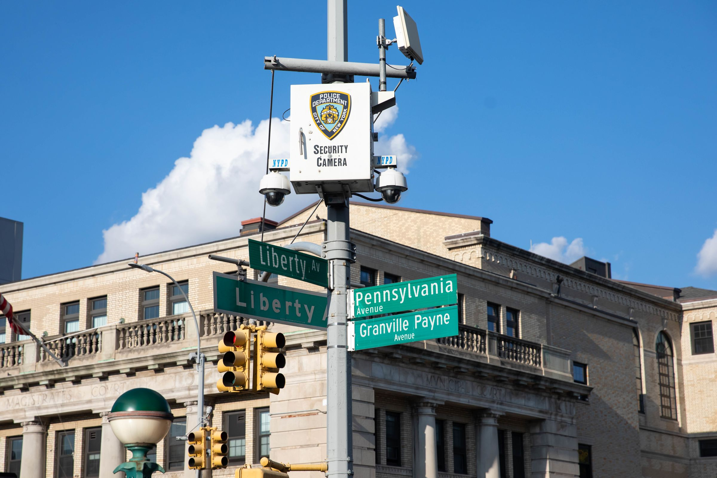 An NYPD security camera is mounted across from an NYPD community center in the 75th precinct in East New York, Brooklyn.