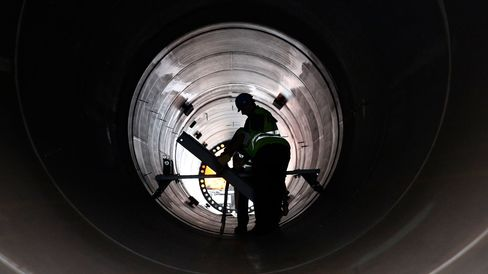 Workers inspect the inside of a large pipe in Invergordon, U.K.