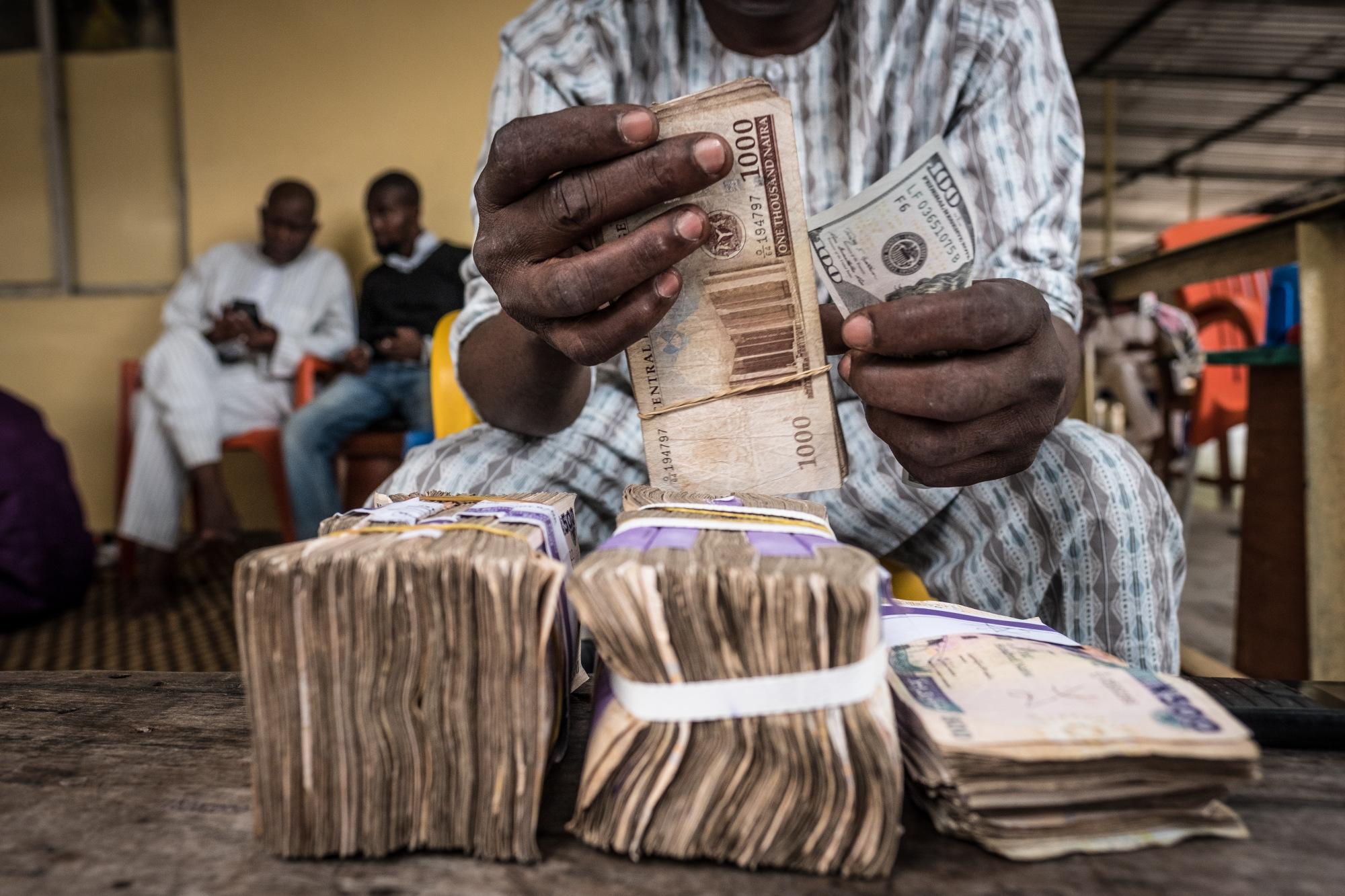 bloomberg.com - Yinka Ibukun - Nigerians Bury Cash in Backyard Banks as Mobile Money Stumbles