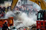 Rescue workers search the rubble of the building in Istanbul.