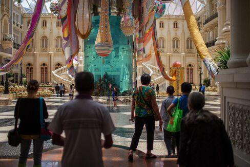 People walk past the Valkyrie Octopus art installation at the MGM Macau casino resort