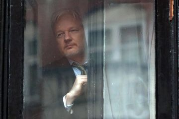 Assange preparing to speak from the balcony of the Ecuadorian embassy on February 5, 2016 after the United Nations Working Group on Arbitrary Detention has insisted that he be released.