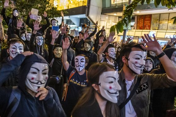 China Attacks Hong Kong Court Over Mask Ban, Stoking Fears of Legal Intervention