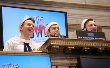 Cory Lingner, Brandon Leffler and Mikey WInslow of Broadway's 'On The Town' Cast Rings NYSE Opening Bell at New York Stock Exchange on Dec. 31, 2014 in New York City.