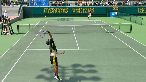 Baylor's Julian Lenz serves to USC's Yannick Hanfmann during an NCAA men's team quarterfinal on May 16, 2015, in Waco, Tex.