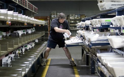 Postal worker Ray Jaeger sorts mail