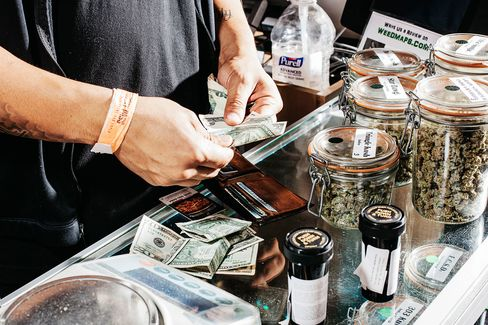 A customer pays for his marijuana purchase at a shop in Denver, on April 19, 2015.