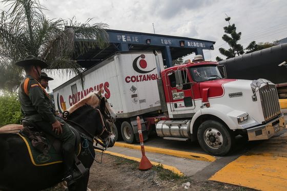 Aid Trucks Arrive as Maduro's Forces Dig In at Border Bridge