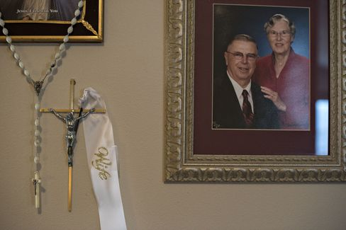 A portrait of Henry Rayhons and his late second wife Donna in the living room of Rayhons's condo.