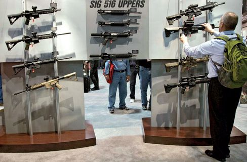 Sizing up some Sig Sauer rifles at the 35th annual SHOT Show on Jan. 15 in Las Vegas