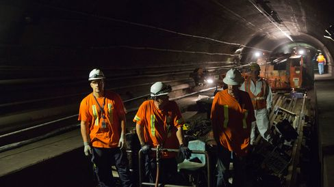 Amtrak crew members work at a repair site in the north tube of the North River Tunnel under the Hudson River near near Weehawken, New Jersey, on Aug. 21, 2015.
