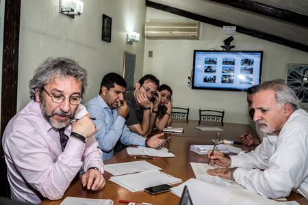 Dundar and his senior staff plan the next day's front page.