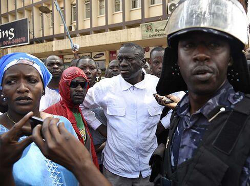 Kizza Besigye, center, in Kampala