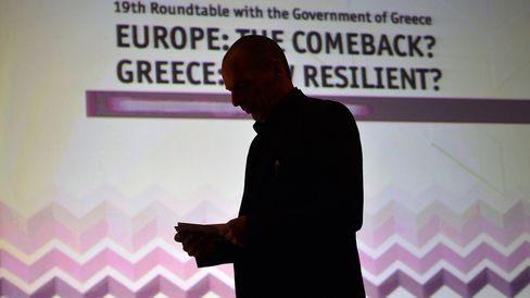 Greek finance minister Yianis Varoufakis stands prior to deliver a speech during the Economist conference entitled