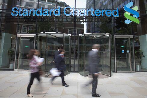 Pedestrians Pass The Standard Chartered Plc Headquarters