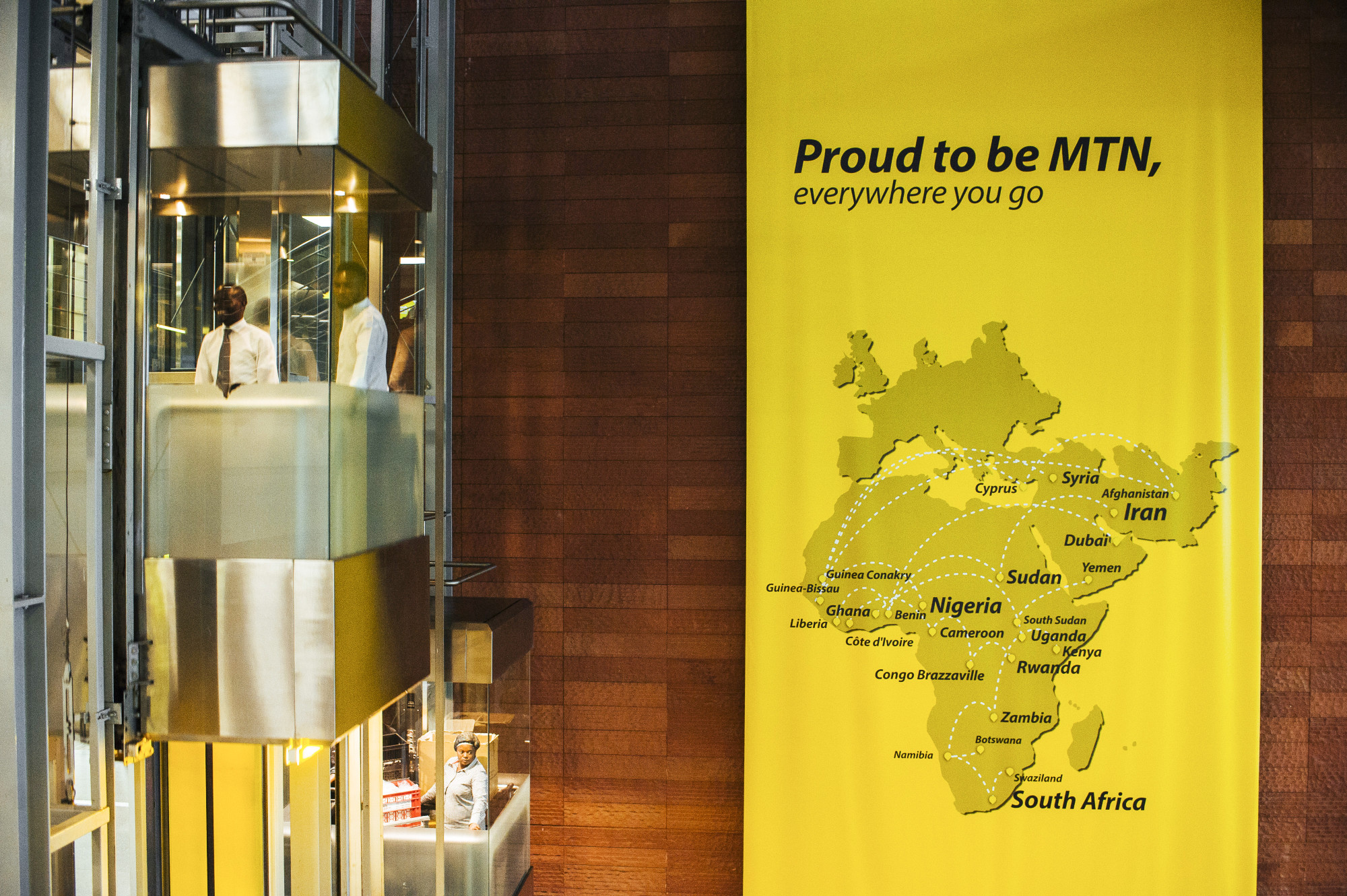 A map of African operations hangs on a wall near a glass elevator at MTN Group Ltd.'s headquarters in Johannesburg, South Africa.