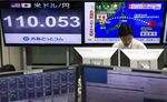 A dealer works in front of monitors displaying the exchange rate of the yen against the U.S. dollar, left, and a news broadcast of North Korea's missile launch at a foreign exchange brokerage in Tokyo, Japan, on Friday, Sept. 15, 2017.