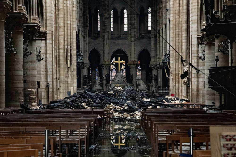 d5cabb1c Fire damaged wood and stone sits near the altar inside Notre Dame Cathedral  in Paris,