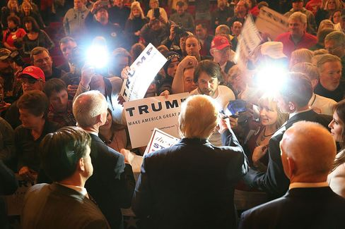 Republican presidential candidate Donald Trump greets people as he attends a campaign rally at the Orpheum Theatre on Jan. 31, 2016, in Sioux City, Iowa.