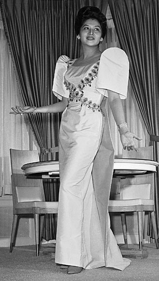 1963: The former pagent queen shows off a traditional gown
