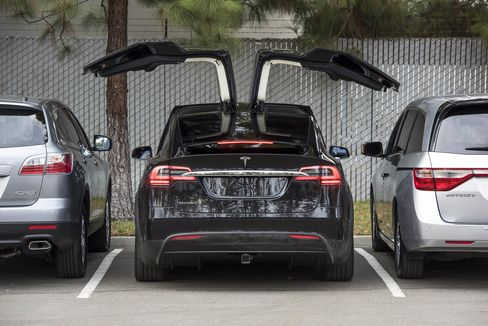 The Tesla Model X SUV. Elon Musk handed over the first six Model Xs to owners in California on Tuesday night, as Tesla reached a milestone of having two all-electric vehicles in production at the same time.