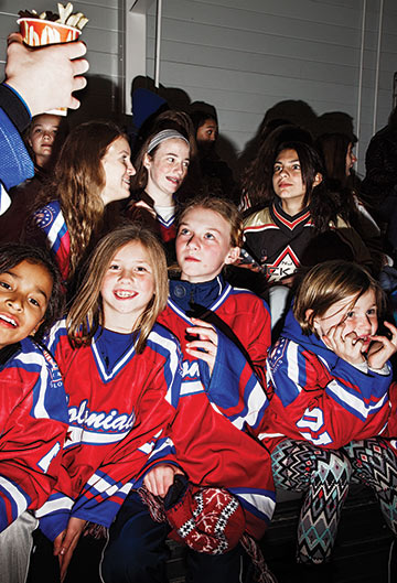 Young fans cheer on the Riveters.