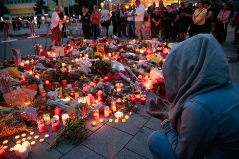 People mourn in Munich on July 23.