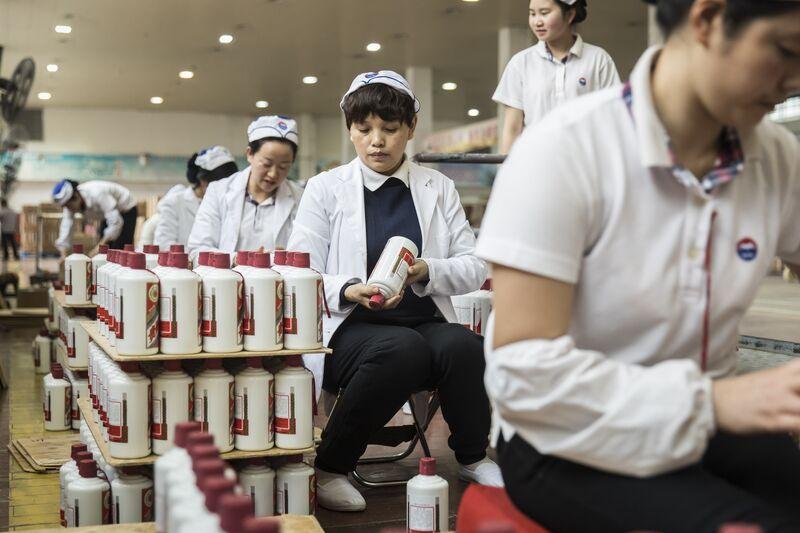 Employees arrange bottles of Moutai baijiu at the Kweichow Moutaifactory in the town of Maotai in Renhuai, Guizhou province, China.