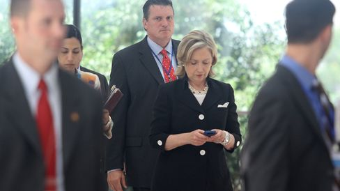 Secretary of State Hillary Clinton looks at her mobile phone after attending a Russia-U.S. meeting on the sidelines of the 43rd annual Association of South East Asian Nations (ASEAN) meeting in Hanoi on July 23, 2010.