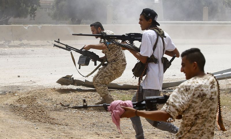 Fighters loyal to the Government of National Accord open fire in the al-Sawani area, south of Tripoli, in 2019.