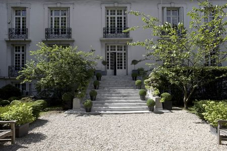 Steps leading up to the Directoire-style facade.