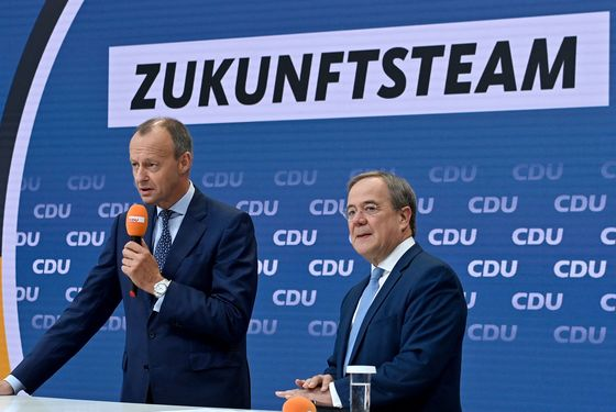 Merkel Heir Turns to Former Rival Merz to Reverse Poll Slump