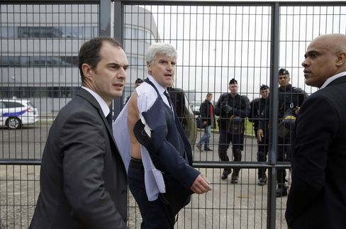 Air France's Pierre Plissonnier, center, walks away from the crowd in Roissy-en-France, yesterday.