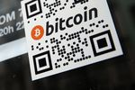 A sticker on the window of a local pub indicates the acceptance of Bitcoins for payment.
