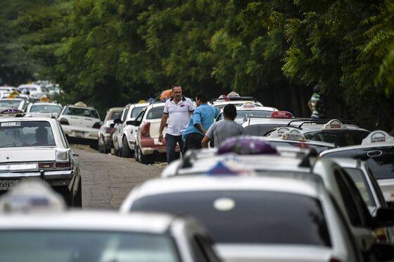 As Gasoline Pumps Run Dry, Venezuelans Resort to Plastic Jugs