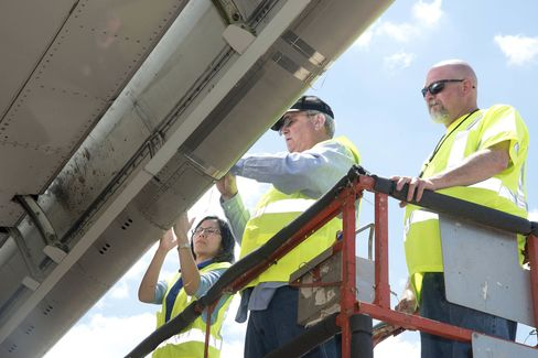Researchers count insect residue on the wing of the ecoDemonstrator 757 aircraft.