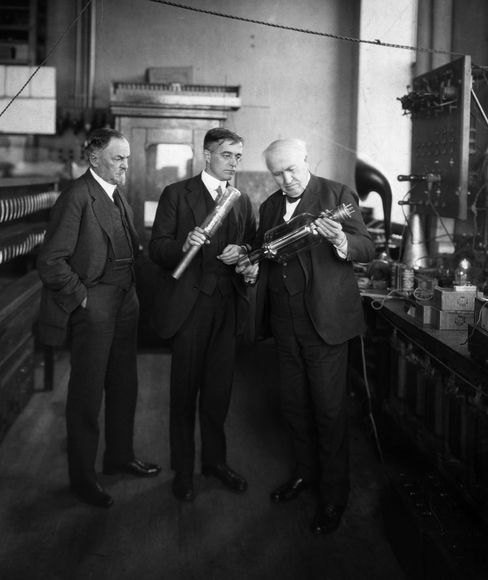 Thomas Edison, right, and Dr. Irving Langmuir, center, are shown discussing the vacuum tube at the General Electric Research Laboratory in Schenectady, N.Y., circa 1904-25.