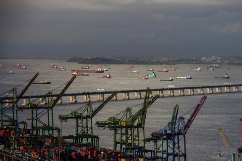 Cranes and shipping containers at a port in Rio de Janeiro, Brazil, on May 20, 2015.