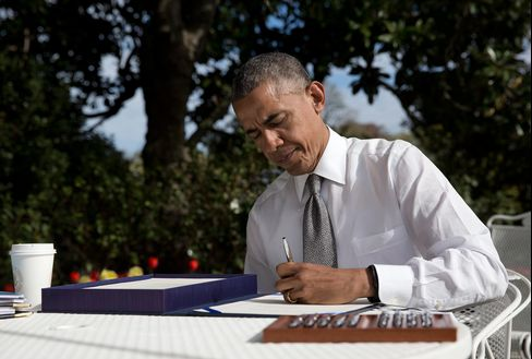 In this April 16, 2015, photo, President Barack signs the bill H.R. 2 Medicare Access and CHIP Reauthorization Act of 2015 in the Rose Garden of the White House in Washington D.C.