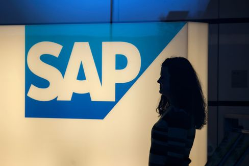 A Visitor Passes a SAP AG Logo at the Company Headquarters
