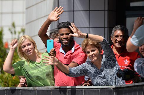 Dilma Rousseff and supporters gather outside Luiz Inacio Lula da Silva's house