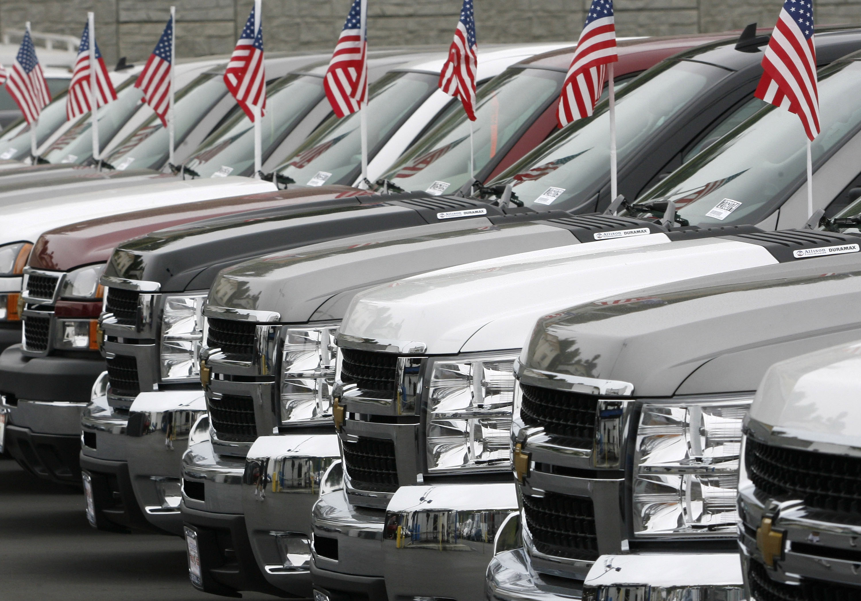 Pickup trucks with American flags affixed to their attennas