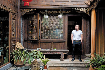 Bei, in Lijiang's old town, where 95 percent of residents are urban refugees