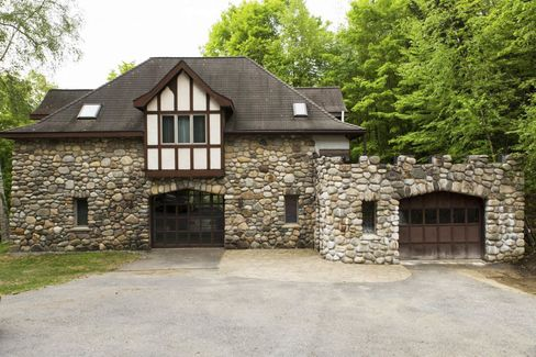 The property includes a two-bedroom carriage house and a two-bedroom gatehouse.