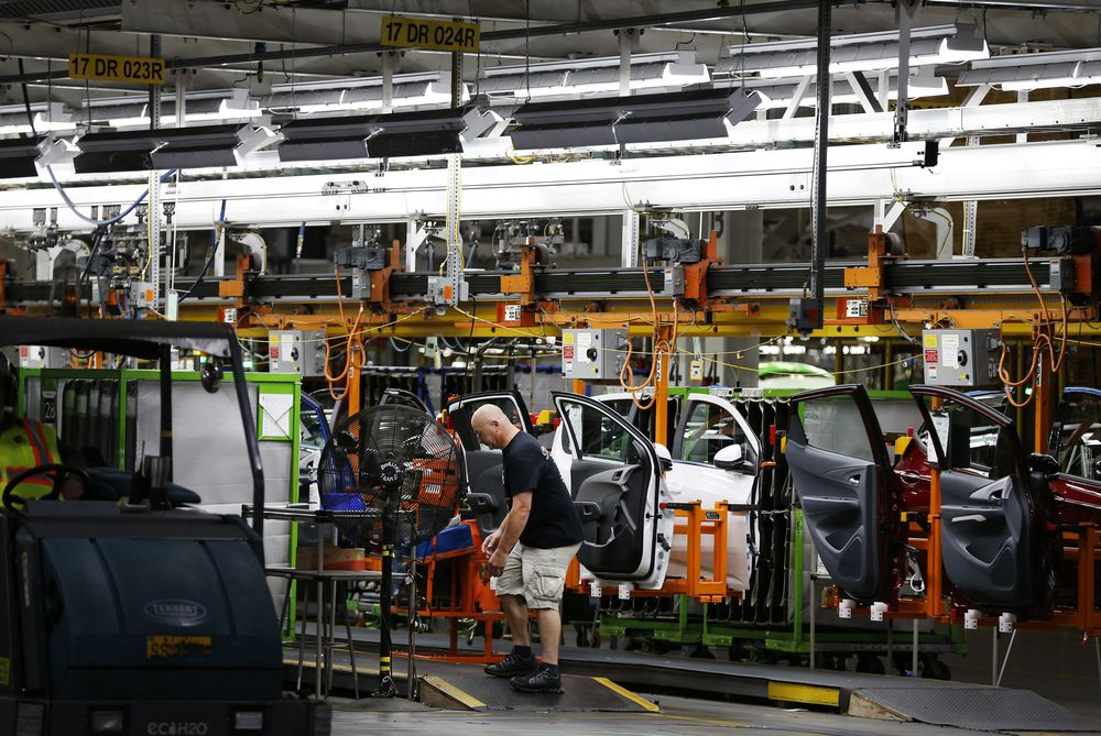 An Employee Works On The Production Line At General Motors Orion Embly Plant