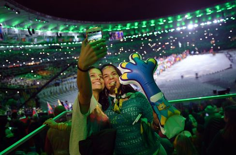Spectators take a selfie picture during the Olympics closing ceremony in Rio de Janeiro on Aug. 21.