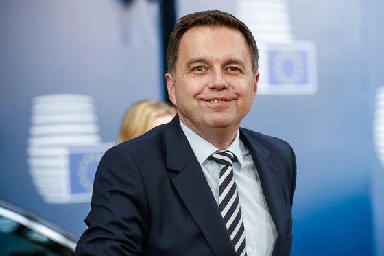 Scourge of Greece Seeks ECB Job as Slovak Governor Eyes the Door