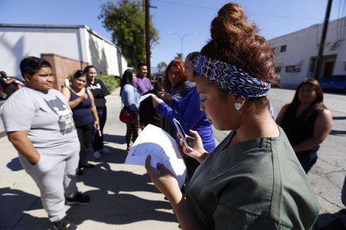 Ruby Maldanado, 20, a Medical Assistant student, checks her phone for the email sent to students that have been turned away at the gate to Everest College on April 27, 2015 in Alhambra, Calif.
