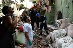 People remove debris of a collapsed building in Mexico City on Sept. 19.