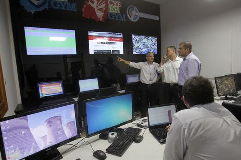 CyberGym employees based in the control centre respond to a